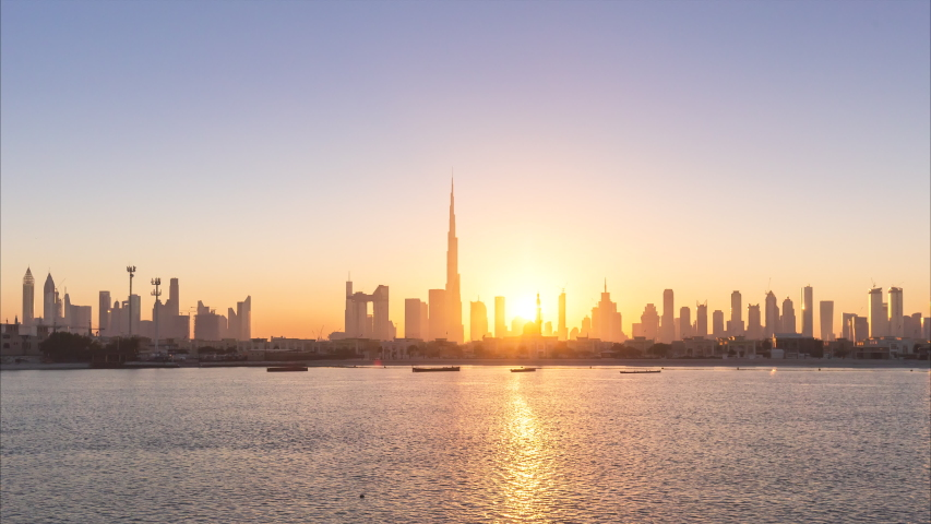 4K Time lapse - Urban Skyline and modern skyscrapers in Dubai UAE at sunrise.
