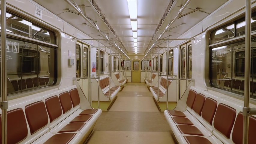 Perspective up view of subway car. Moscow metro. Empty metro wagon lately in evening. Royalty-Free Stock Footage #1031852720