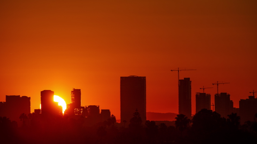 Time Lapse of the sun rising from behind downtown Los Angeles | Shutterstock HD Video #1031886758