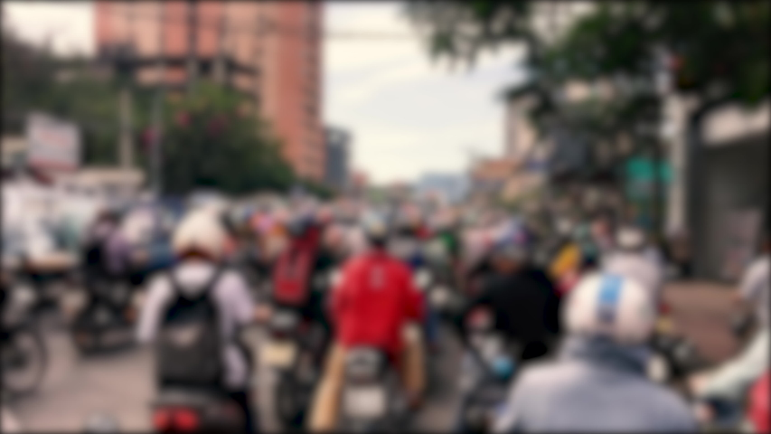 Traffic jam and rush hour in Vietnam. Slow moving traffic with lots of vehicles transport on the road in office hours. Stock footage defocus of urban infrastructure problem, traffic congestion Asia #1031891918