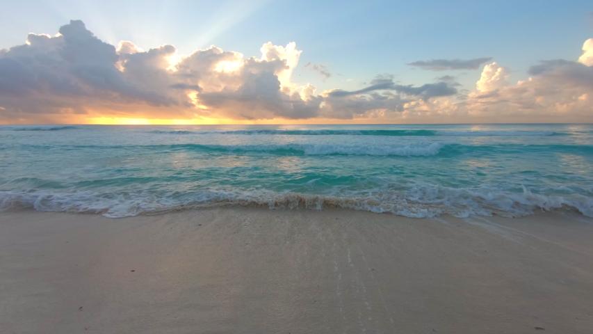 Beach sunrise and crashing waves on the beach | Shutterstock HD Video #1031895197
