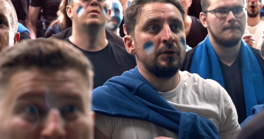 CU portrait of Caucasian male cheering together with fans during a sport event. 4K UHD