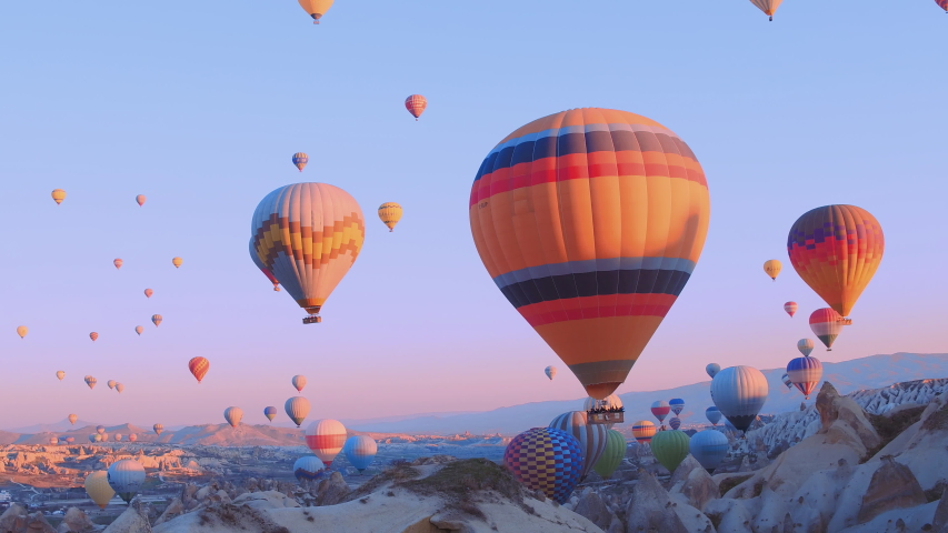 hot-air balloons flying over the mountain landsape of Cappadocia,Turkey.