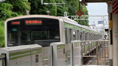 TOKYO, JAPAN - JUNE 23RD, 2019. Japan Railway Yamanote train at Harajuku train station.