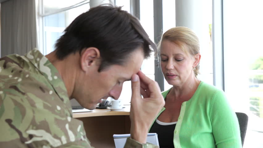 Soldier discussing problems with counsellor who listens and takes notes. Shot on Canon 5D MkII at 25fps | Shutterstock HD Video #10319198