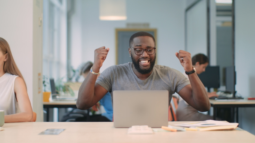 African business man feeling happy of work results. Excited man getting good project results at coworking space. Closeup man enjoy perfect letter at coworking. | Shutterstock HD Video #1031923727