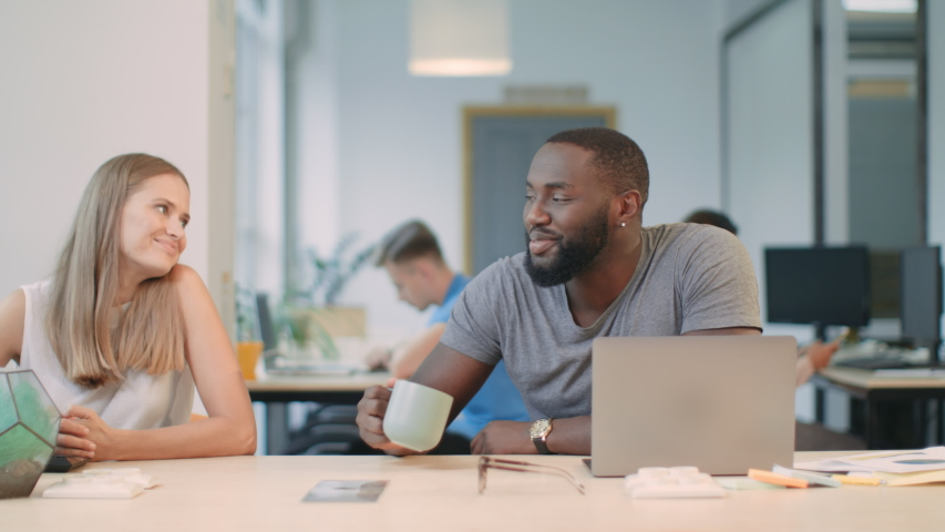 Business man sleeping with laptop at coworking. Smiling woman giving coffee to sleepy colleague. Happy man waking up after coffee at workplace. Black man saying thank you to colleague in office.   Shutterstock HD Video #1031923754