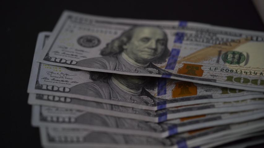 US Currency, $100 bill. .   Shutterstock HD Video #1031949149
