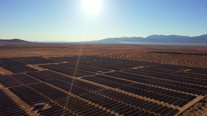 Aerial Pan Right/Down: Solar Panels Covering Part Of Desert - Palm Springs, California   Shutterstock HD Video #1031959886