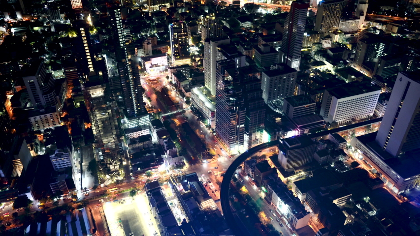 Top aerial view from tower rooftop, road junction traffic skyscrapers and busy evening highways night transition in modern downtown of Bangkok thailand.  | Shutterstock HD Video #1031961116