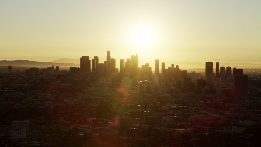 Aerial cityscape view with sun flare central Los Angeles and sunrise over financial district skyscrapers California USA #1032005867