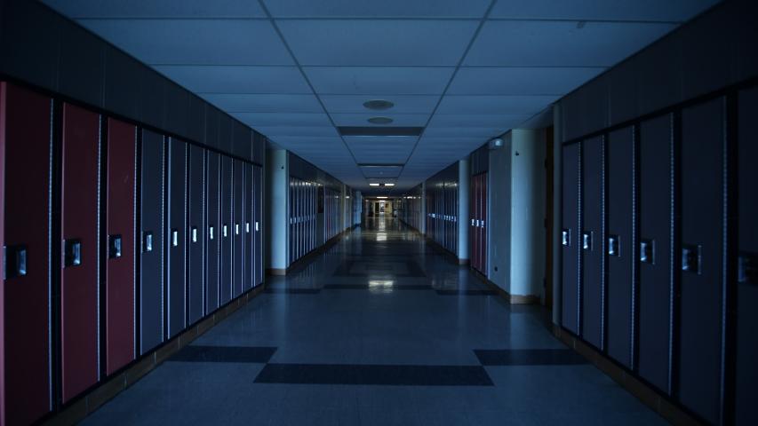 Dark highschool hallway full of lockers gimbal stabilized walkthrough.