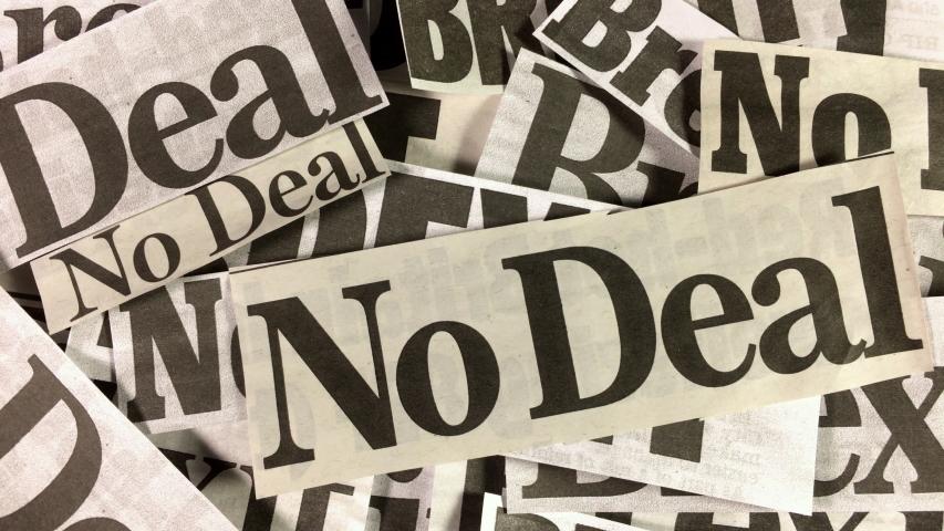 Tilt down over No Deal Brexit newspaper headline cuttings. | Shutterstock HD Video #1032036494