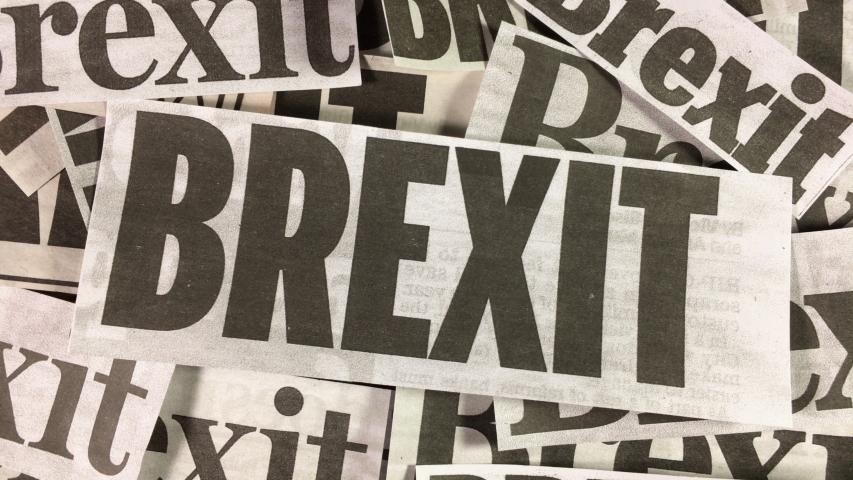 Tilt down over Brexit newspaper headline cuttings. | Shutterstock HD Video #1032036500