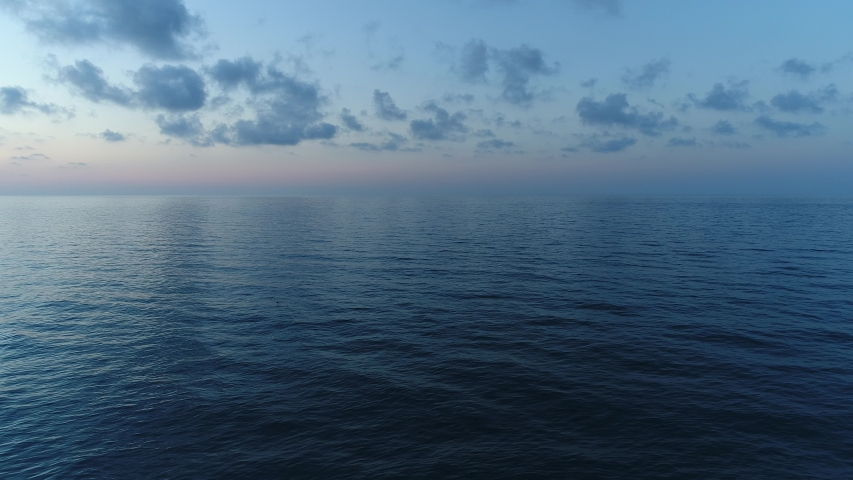Dark calm sea and sky in the evening. Beautiful sea background, aerial view. #1032036716
