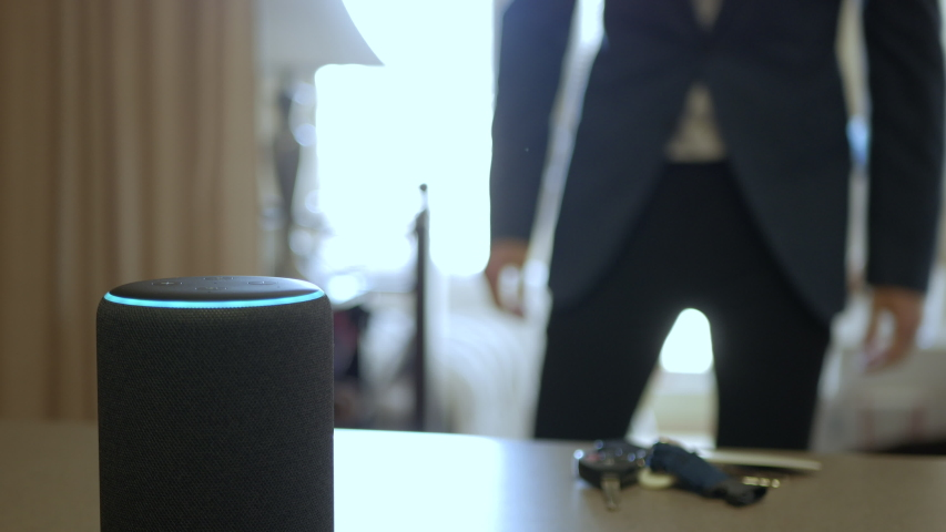 Smart Home Device, Man Getting Ready For Work In The Background.