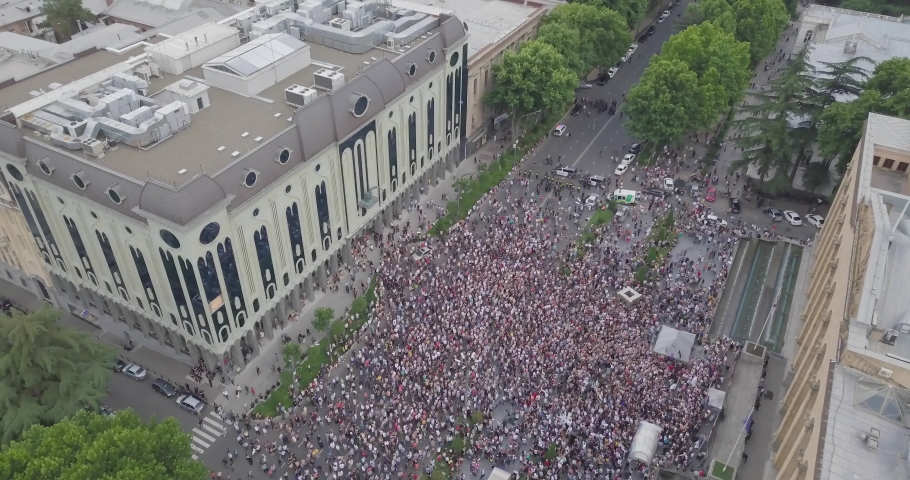 Top Aerial shot on Protesting people manifestation in Tbilisi around parliament