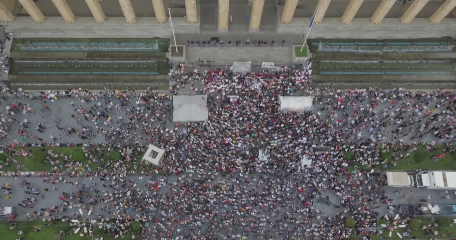 Top Aerial shot on bunch of people manifestation in Tbilisi around parliament