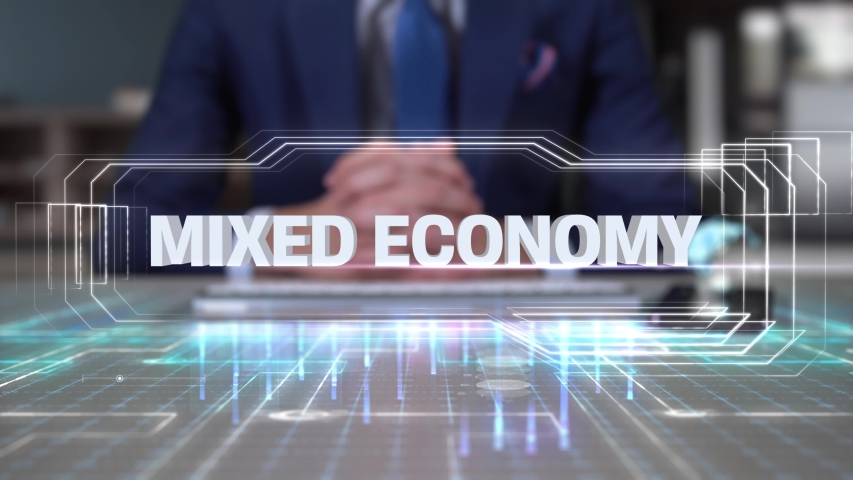 Businessman Writing on Hologram Table Economics Word- Mixed economy | Shutterstock HD Video #1032080921