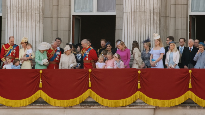 LONDON, circa 2019 - Queen Elizabeth II and the British Royal Family wave at the crowds from the balcony of Buckingham Palace in London