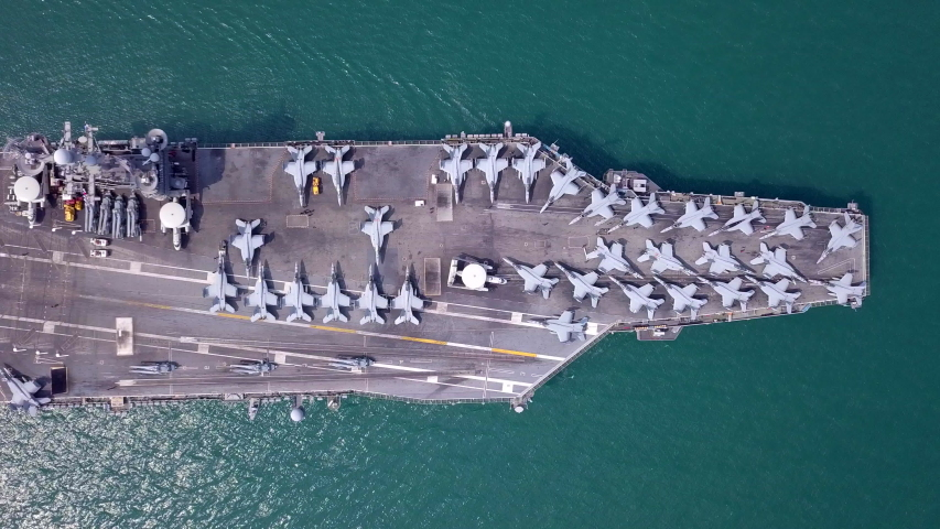 Aircraft carrier battleship military navy nuclear ship carrier and loading fighter jet aircraft and F-35 Fighter United States