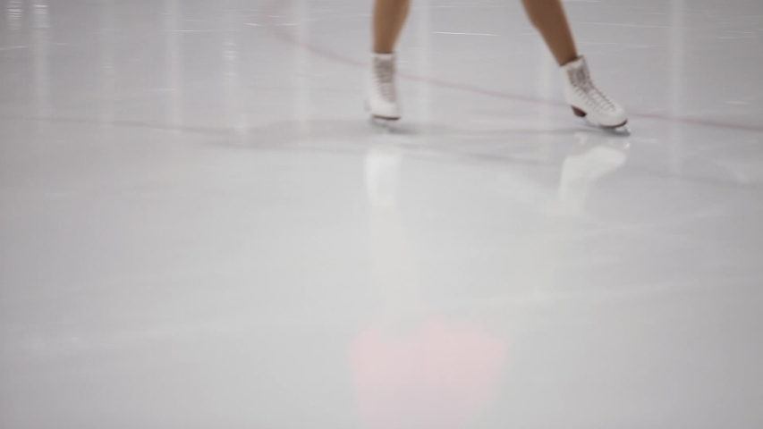 Figure skating, ice skating training. Feet skater on the ice, close-up,