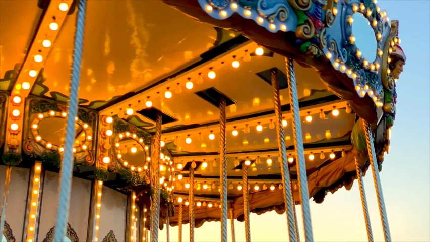 A merry-go-round, or carousel spinning at sunset Royalty-Free Stock Footage #1032124100