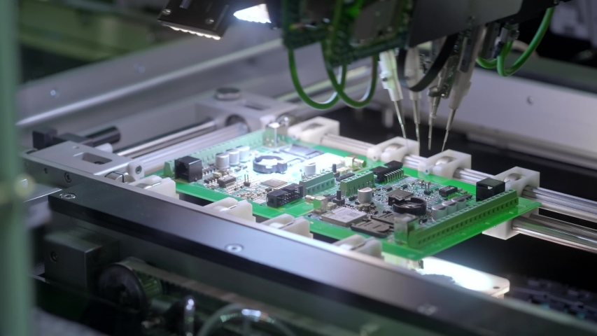 Electronic circuit board production. Automated Circut Board machine Produces Printed digital electronic board. Electronics contract manufacturing. Manufacture of electronic chips. High-tech Royalty-Free Stock Footage #1032131765
