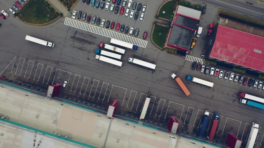 Aerial Shot of Industrial Warehouse Loading Dock where Many Truck with Semi Trailers Load Merchandise. #1032132338