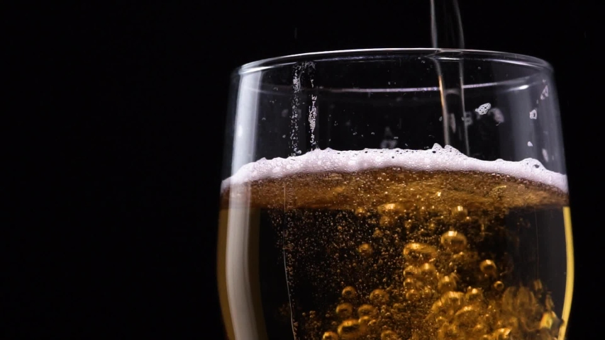 Close-up Macro Shot Of Beer Bubbles Rising Upwards When Pouring From A Pint On A Black Background. The Concept Of Fresh Draft Beer In The Bar | Shutterstock HD Video #1032142946