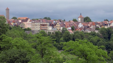 ROTHENBURG OB DER TAUBER, GERMANY - JUNE 12 , 2019: Southern view of Rothenburg from the castle garden. Zoom out