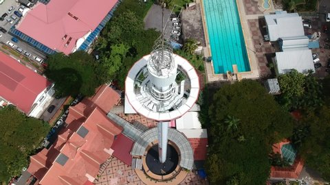 """Malacca, Malaysia- Circa June, 2019: An aerial view of Menara Taming Sari Melaka in the morning. Its a panoramic ride view in Malacca."""