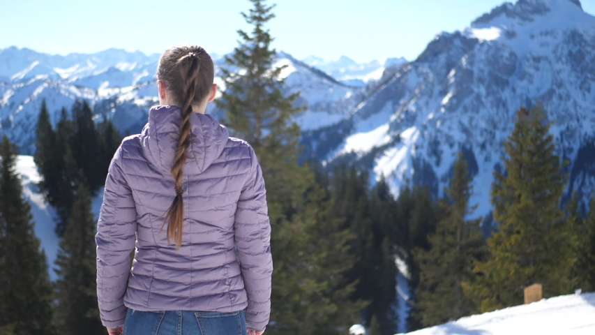 Woman watching the mountains with snow | Shutterstock HD Video #1032181409