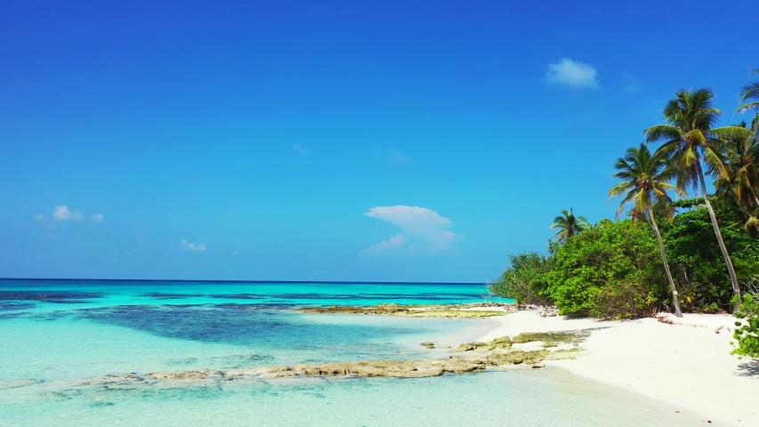 Luxury island resort on exotic white sand Rocky beach   Shutterstock HD Video #1032194153