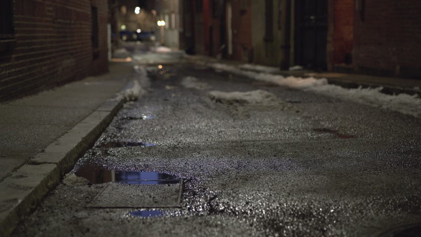 Dark side street of large city with puddle of water 4k | Shutterstock HD Video #1032215144