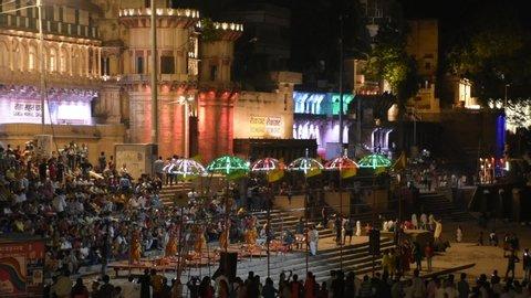 VARANASI INDIA JUNE 2019 : Varanasi (Banaras) Ganga aarti ceremony rituals performed by Hindu priests. Costumed Hindu performs traditional Ganges prayer with fire the Ganga Aarti rituals in evening