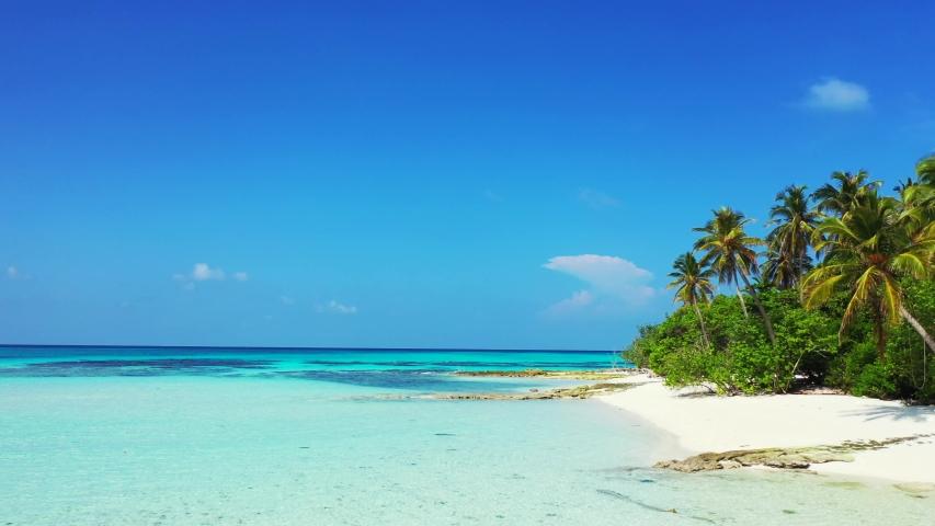 Caribbean drone aerial footage of tropical island coast near crystal clean ocean water caribbean   Shutterstock HD Video #1032226574
