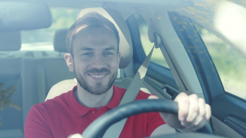 Happy young smiling man driving a car on a road trip sunset sunlight transport holiday happy adventure car short hair free time journey smiling summer travel slow motion | Shutterstock HD Video #1032253466