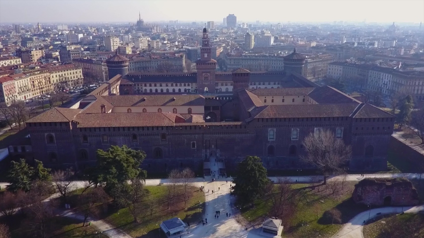 Aerial view of the medieval castle of stone Castello Sforzesco in Milan. Aerial photography with the help of a drone. Horizon. Architecture of urban construction. Historical monuments of Italy #1032270287