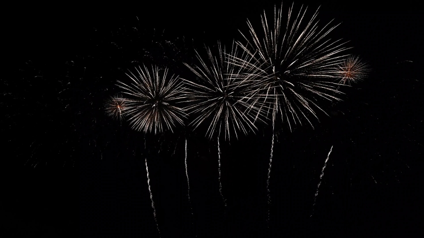 Real Fireworks footage 4k video on Deep Black Background Sky on Futuristic Fireworks festival show before independence day on 4 of July