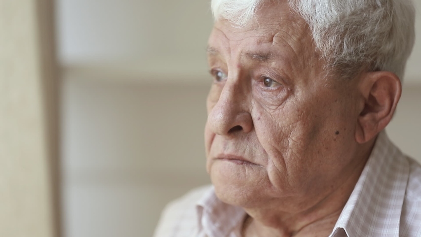 Pensive elder senior man looking away feel upset, thoughtful melancholic older retired gray haired grandpa suffer from sorrow grief loneliness, sad grandfather widower alone at home, close up view