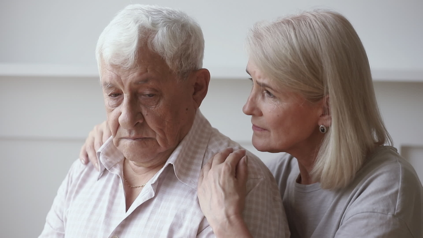 Caring middle aged mature wife asking to forgive embracing comforting talking to upset old senior husband apologizing giving support empathy saying sorry, retired couple apology, forgiveness concept | Shutterstock HD Video #1032303722