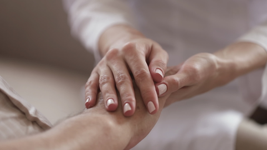 Young kind woman nurse daughter caregiver holding stroking hand of old elder man patient close up view, senior grandparent care, two generations support concept, grandparent healthcare and hope Royalty-Free Stock Footage #1032303731