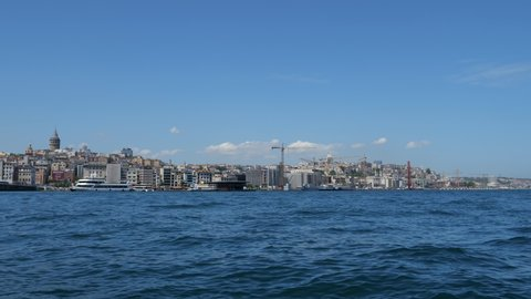 Istanbul, Turkey, 22-05-2019: View from the Bosphorus river with floating ships, boats, cruise liners and downtown, time lapse. Editorial video.