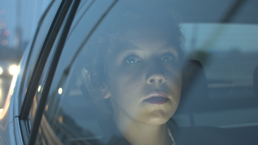 Sad Young Woman Sitting in the Car and Looking Ahead | Shutterstock HD Video #1032323330