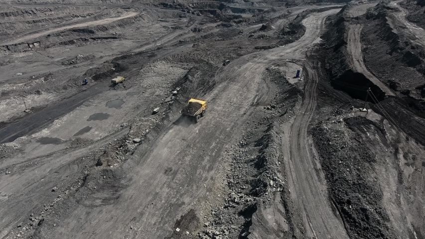 Big yellow heavy truck in open cast mine mining of coal the overall plan. Open pit anthracite mining, mining truck at work working in quarry. Dumpers quarrying industry mining work of machinery trucks | Shutterstock HD Video #1032330113
