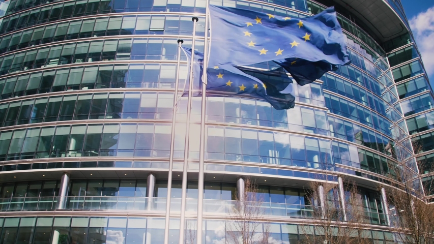 European Union building with waving European Flags (4k) Royalty-Free Stock Footage #1032353366