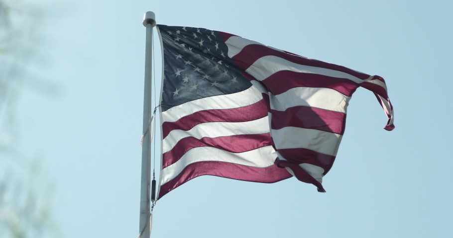 Large American flag blowing in the wind