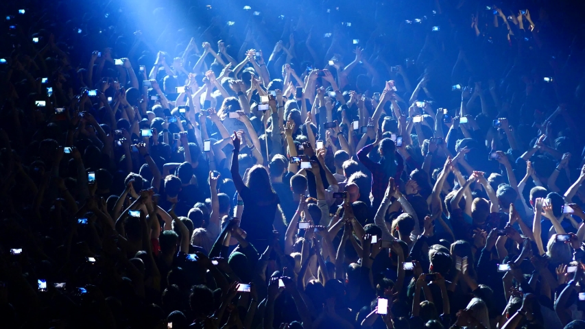 Joyful crowd enjoys listening famous group rock concert   Shutterstock HD Video #1032372821