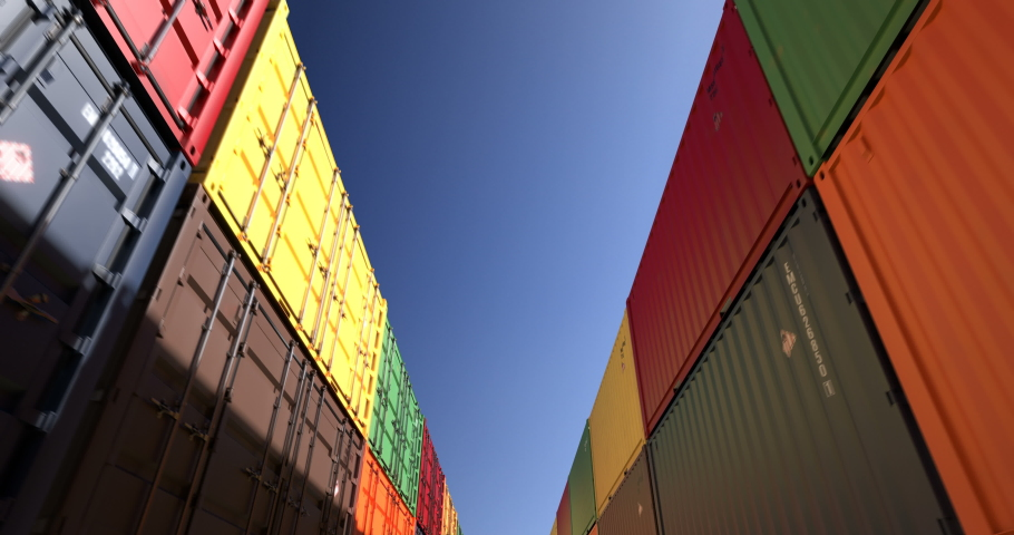 Rows of cargo shipping containers under clear sky. Industrial containers are excellent for cargo import export shipment. Camera endlessly moves thru cargo boxes of different transportation companies Royalty-Free Stock Footage #1032383105